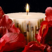 Candle with flower petals surrounding it