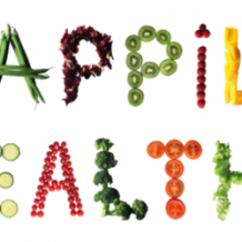 Fruits and vegetables spelling out happily healthy
