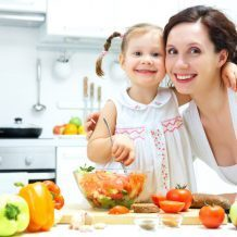 mom and daughter cooking in kitchen