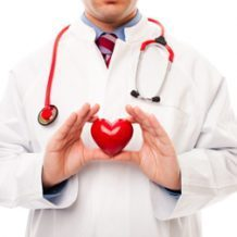 Doctor holding red plastic heart