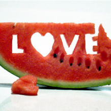 Love carved into slice of watermelon