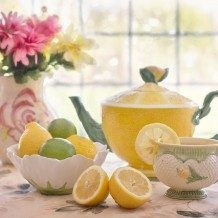 tea set with bowl of lemons