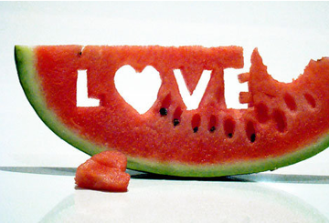 "Watermelon with ""Love"" carved into it"