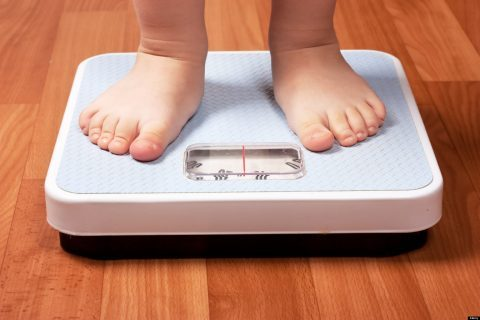 child's feet on scale