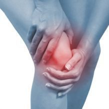 hands holding knee in pain