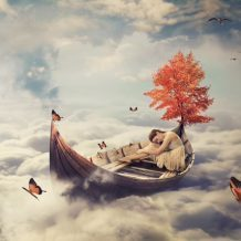 woman sleeping on boat in clouds