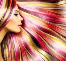 profile of woman with brightly colored hair fanned around her