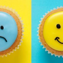 smiley and frowny face cupcakes