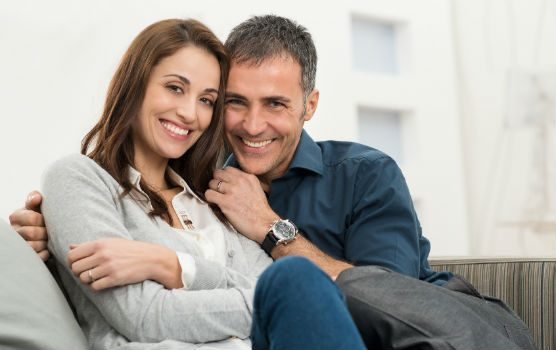Couple smiling while sitting together