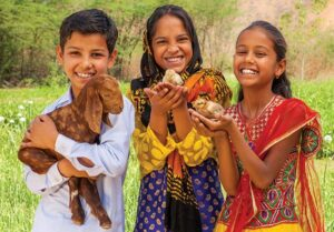 children holding baby animals