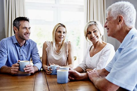a couple sitting down with Older Parents for a family meeting