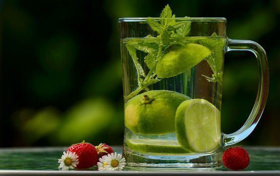 Glass of water with limes and mint