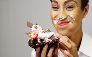Smiling Woman Eating Cake Messily