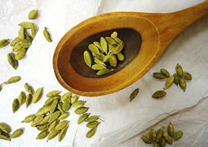 cardamom in wooden spoon