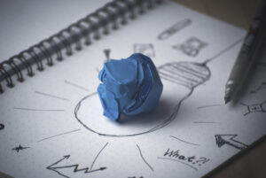 Blue Paper Ball in middle of light bulb drawing