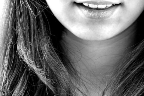 Grayscale Photograph of a Girl smiling