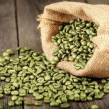 green coffee beans spilling out of bag