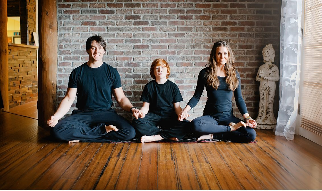 Family sitting and meditating