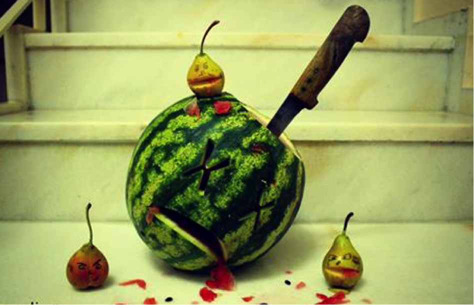 Watermelon stabbed with knife and x's for eyes