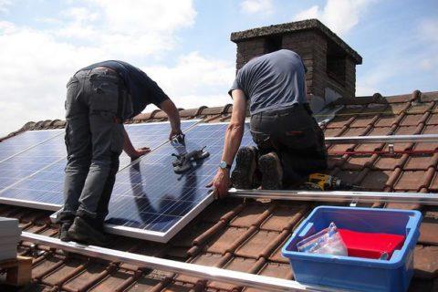 two men installing solar pannels