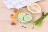 Small jar of honey, plate of cucumbers, and other organic skin care methods