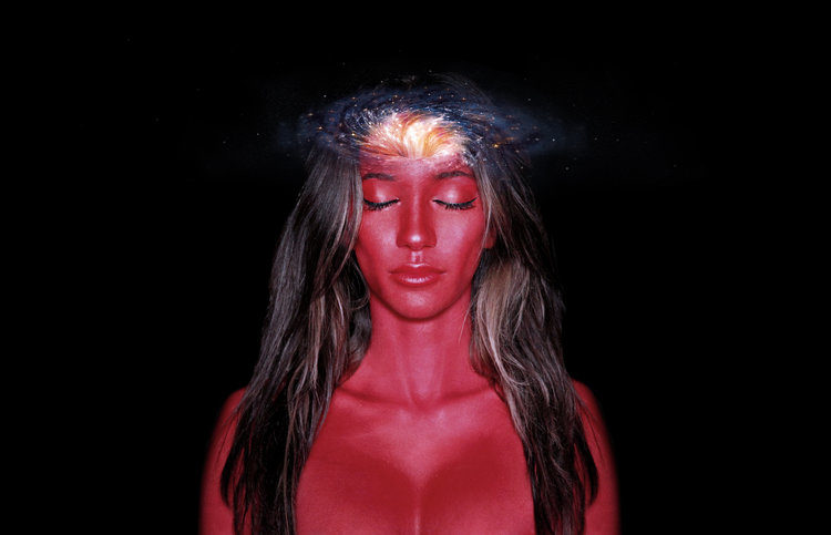 piece of art from the ascension series; pictured woman with black hair and skin painted red standing in the center of a black background with her eyes closed and the cosmos circling her brain