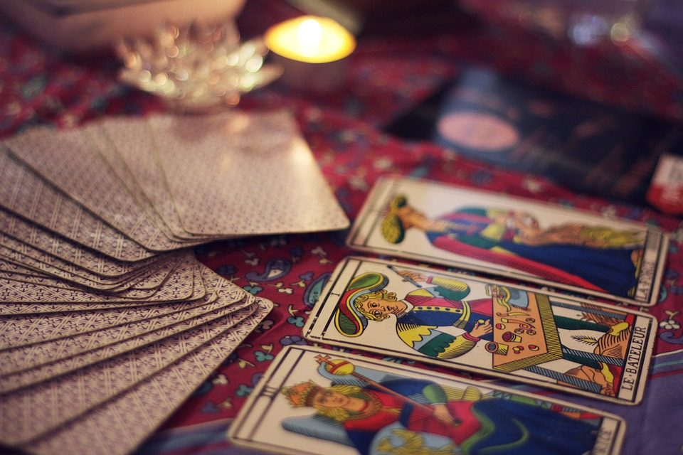 tarot cards placed on a table covered in a red cloth