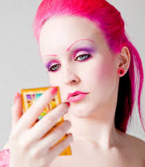 woman who is wearing pink makeup and hair